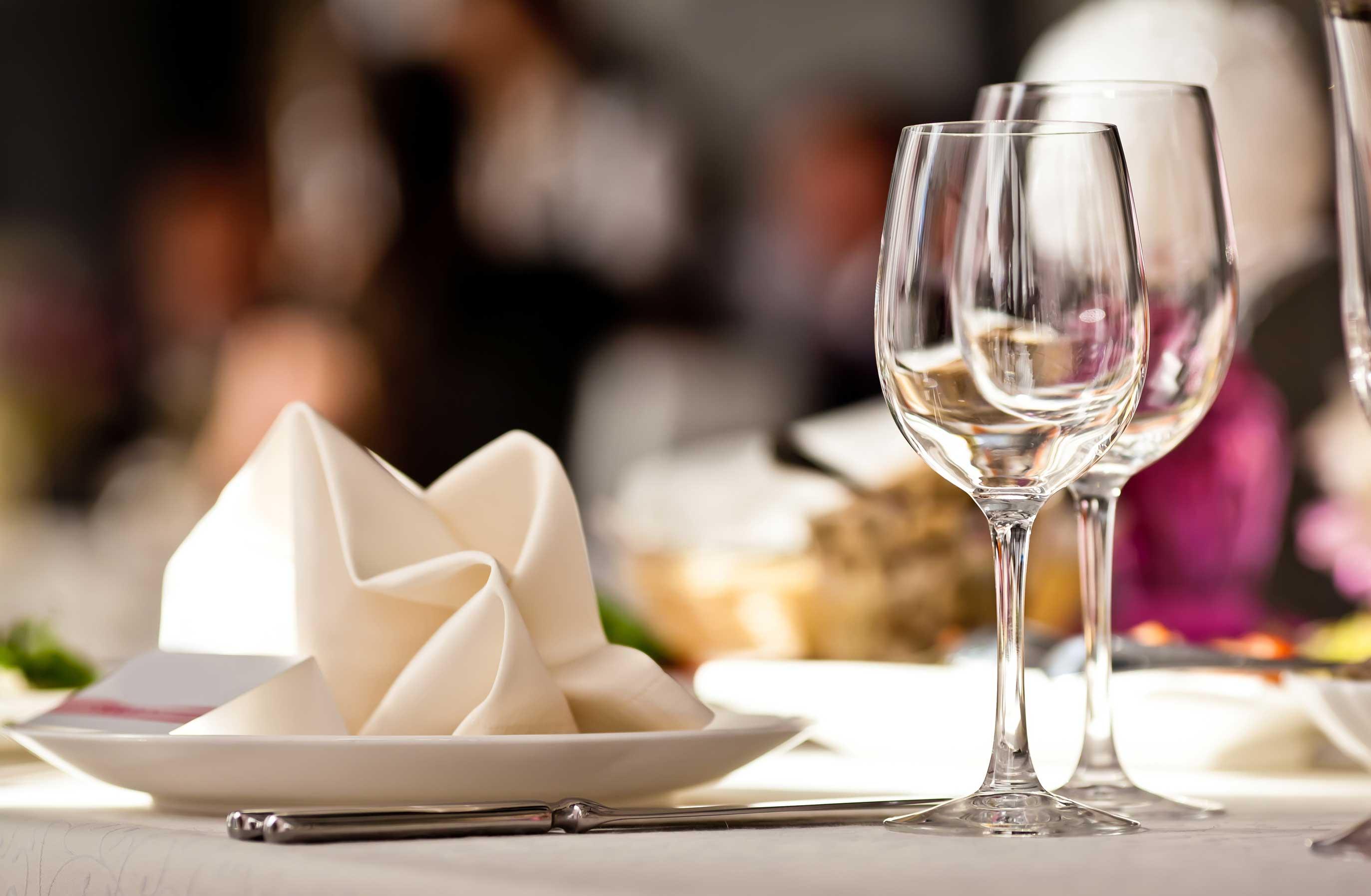 stock-photo-empty-glasses-set-in-restaurant-105118202.jpg