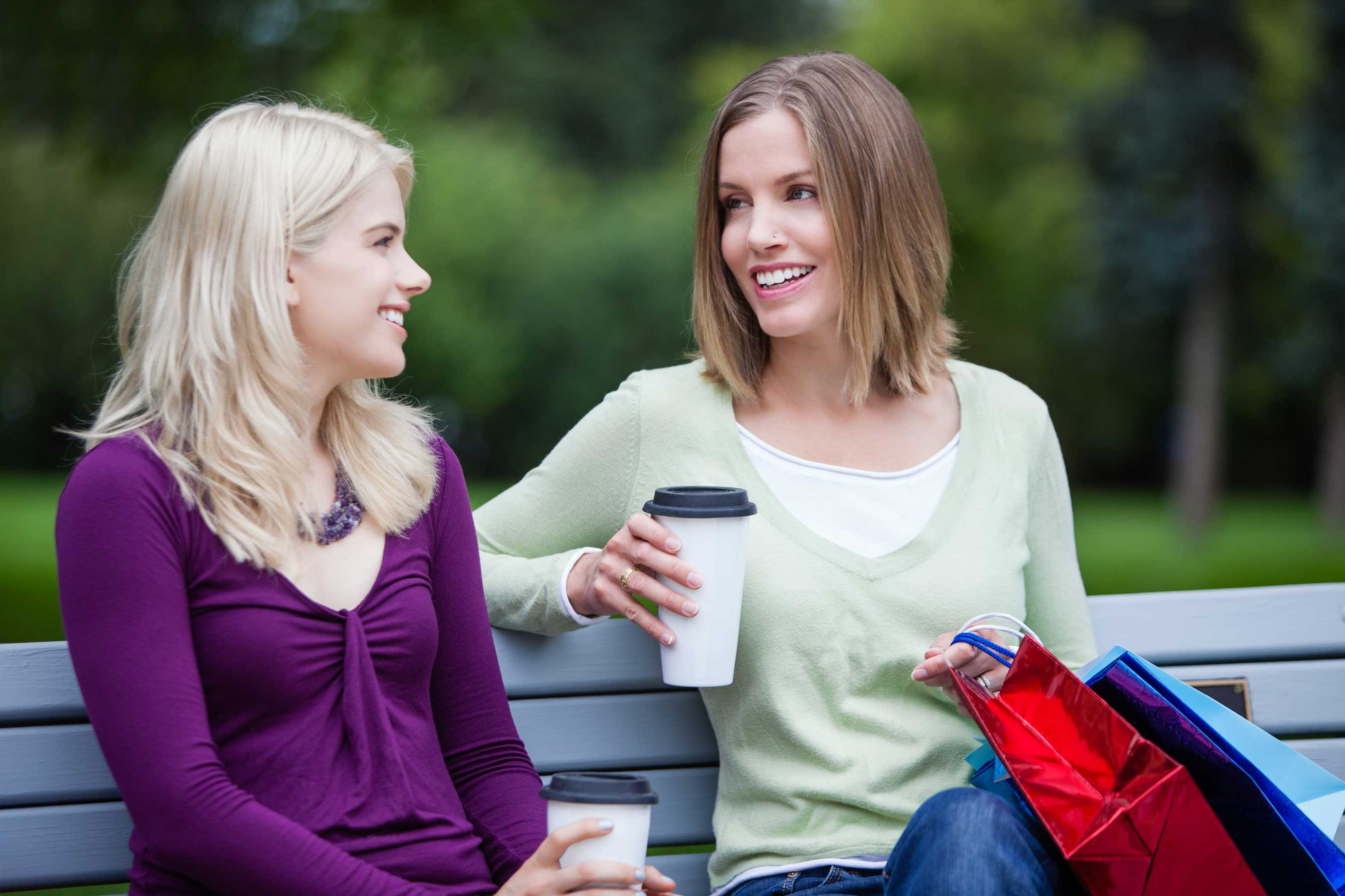 stock-photo-shopping-women-with-takeaway-coffee-on-bench-112589456.jpg