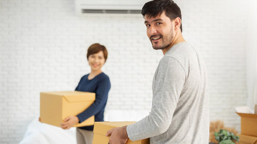 young-couple-moving-boxes